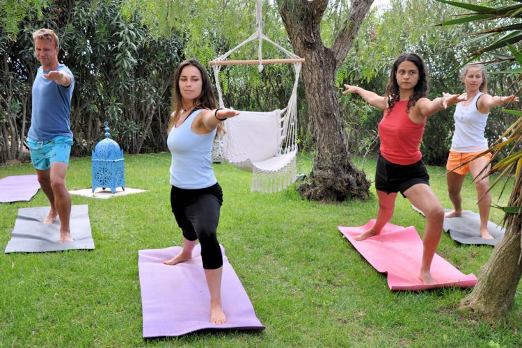 AltaVista guests taking a yoga class in our tranquil tropical garden